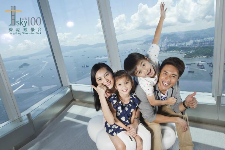 sky100_family happy faces with logo.jpg
